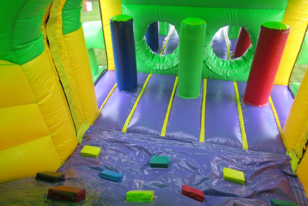 GREEN CROCODILE OBSTACALE COURSE,IT CAN ONLY BE CARRAROE BOUNCING CASTLES
